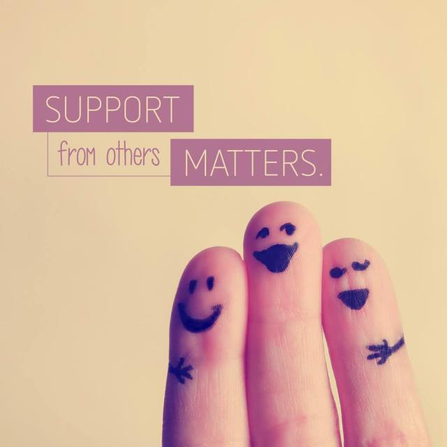 "Photo of three fingers with drawings on them to look like people hugging with text saying ""support from others matters."""