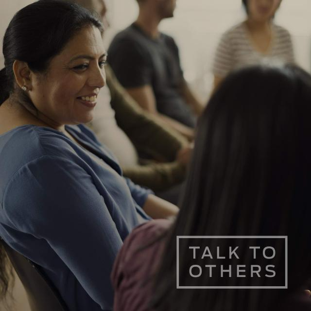 "Women in support group talking with each other with text saying ""talk to others"""