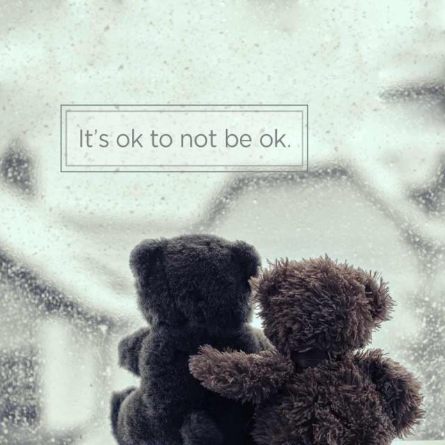 "Photo of embracing teddy bears with text saying ""It's okay to not be okay."""